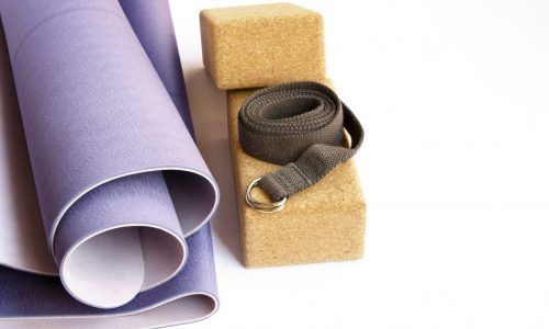 Yoga-accesories-modern-lilac-mat-two-cork-blocks-and-grey-strap-on-white-isolated-background.-Yoga-practice-concept.-680862846_2500x1656-1024x678
